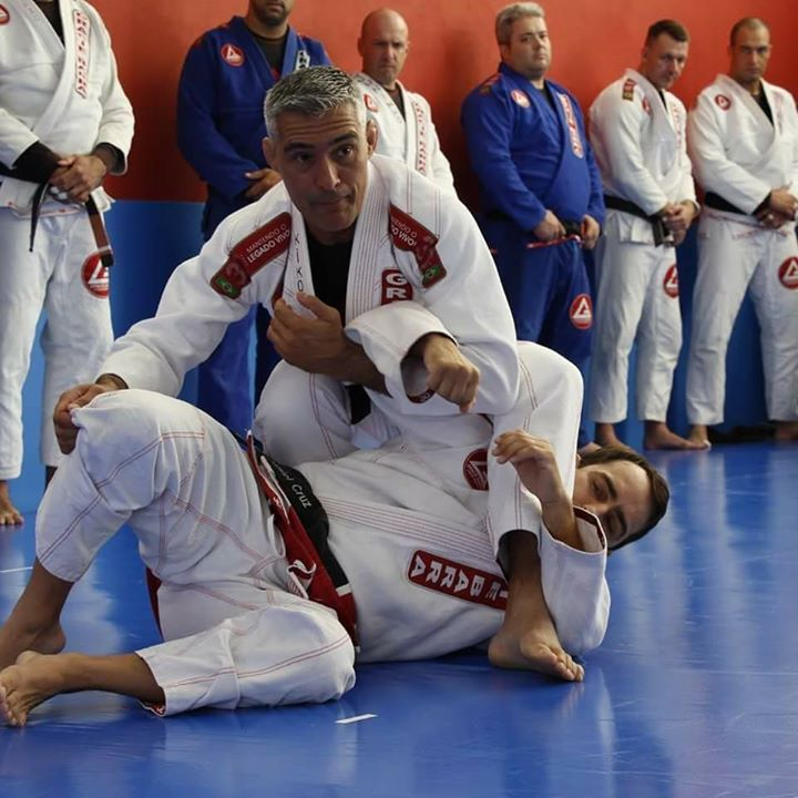 Professor Kiko on the mat with a student