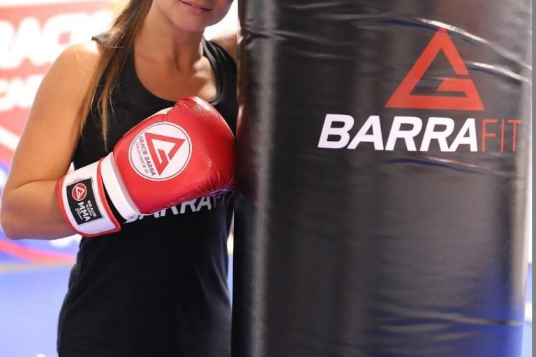 Woman hits punching bag during Gracie Barra Brazilian Jiu-Jitsu class in Peoria