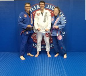 Vastin and Coaches Todd and Val stripe promotion